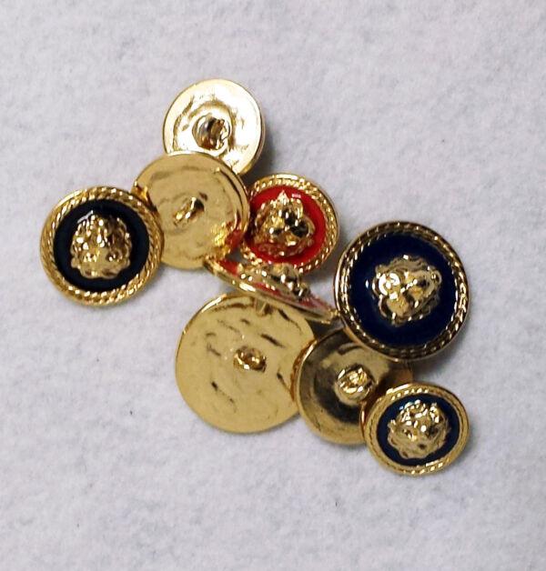 Bottone metallo con disegno in rilievo